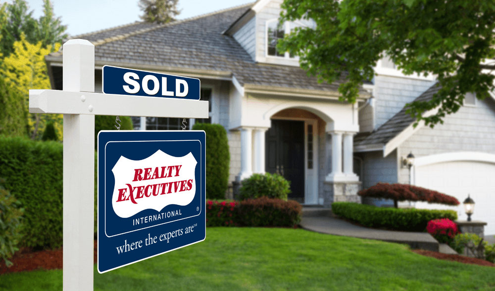 Realty Executives outside of home sold sign
